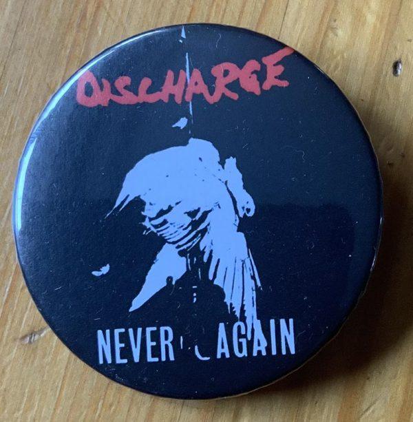 Discharge – Never Again Binlid 52mm Badge